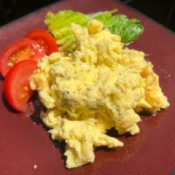 Scrambled Eggs on plate with lettuce and tomato