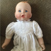 Identifying a Gerber Porcelain Doll - baby doll wearing a long white dress