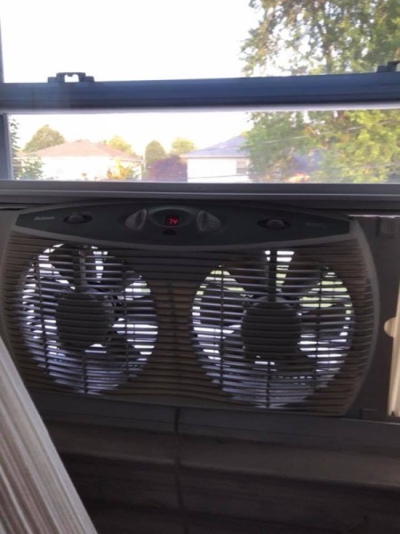 A box fan in a window.