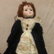 Identifying a Porcelain Doll - doll with a long coat