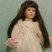 Information and Value of a Dynasty Porcelain Doll - dark haired doll in white long dress