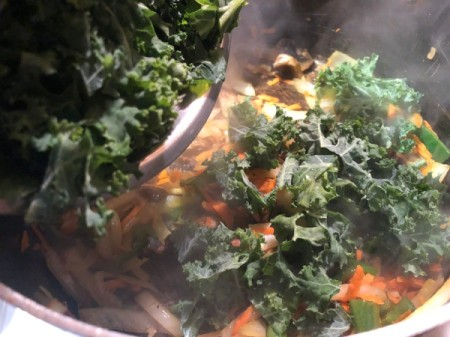 adding kale to pan