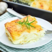 Slice of White Cheddar Au Gratin Potatoes on a white plate.