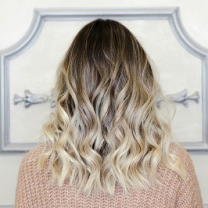 Blond with a Balayage hair dye job.