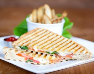 Panini grilled sandwich on a plate.