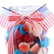Patriotic Decorative Jar filled with red, white and blue candy.