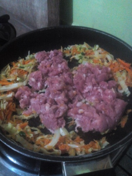 ground meat added to pan