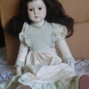 Identifying a Porcelain Doll - doll sitting in front of a box