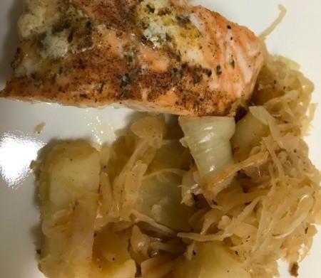 Sautéed Sauerkraut and Potatoes with salmon on plate
