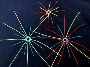 Zip Tie Fireworks Decor - three fireworks bursting decorating hanging in a cluster