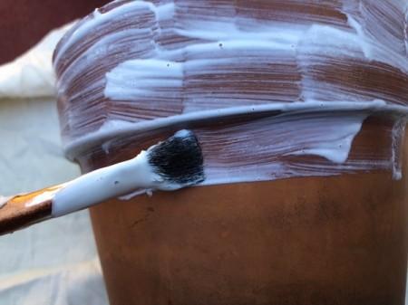 Napkin Decoupaged Flower Pot - brush Mod Podge on outside of the pot