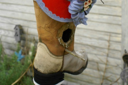Cowboy boot bird house.