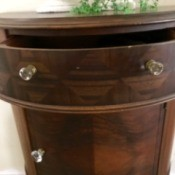Value of a Mersman Demilune Table 4815 - half circle table with a drawer and storage area below