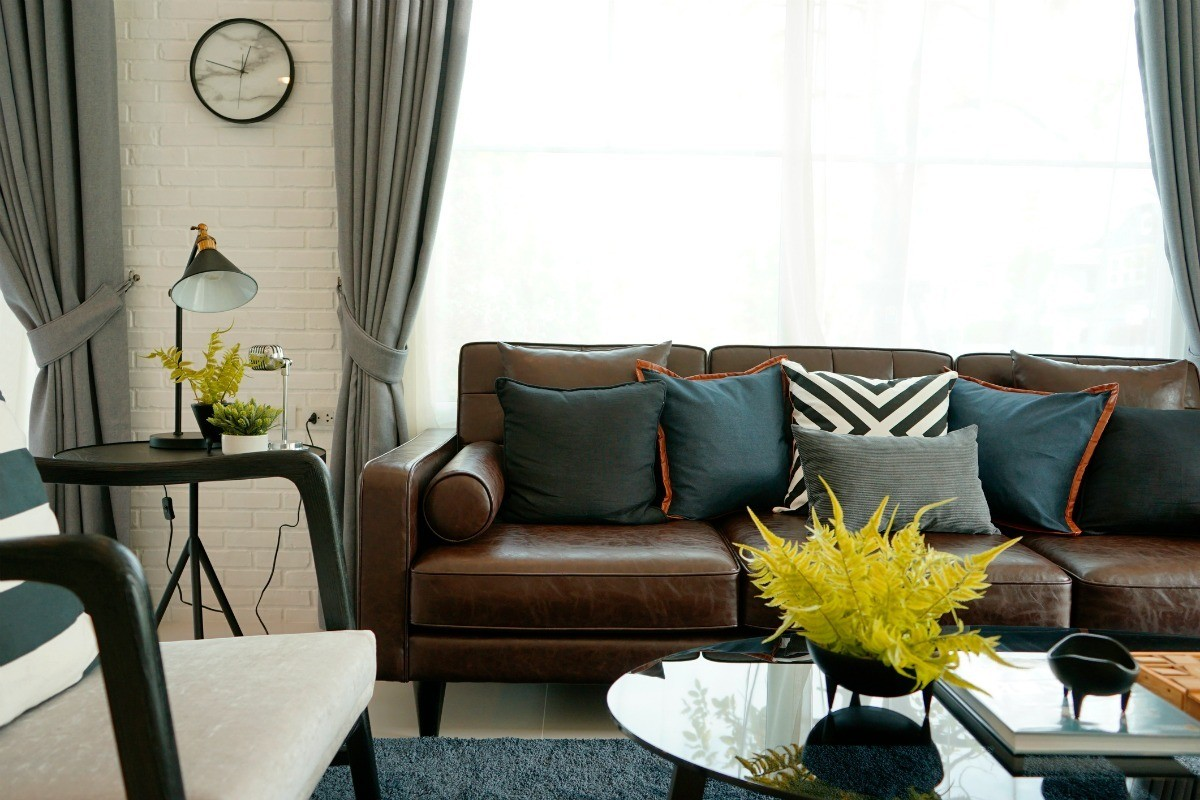 Brown Leather Sofa With Throw Pillows