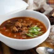 Goulash Soup in a white bowl.