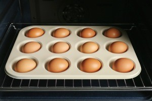 Eggs in a muffin tin in the oven.