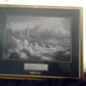 Value of Thomas Kinkade Conquering the Storms - stormy seas and lighthouse