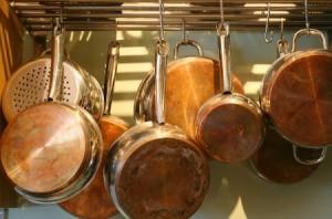 Pots and pans on a pot rack.