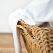 Sheets in a laundry basket.