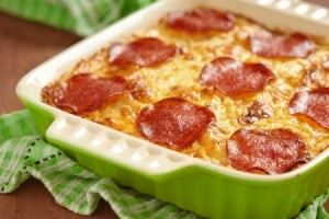 Cavatini in a casserole topped with pepperoni.