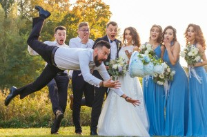 Man in wedding party drops the cake.