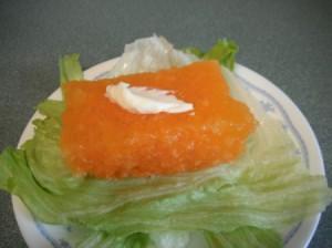square of jello on lettuce