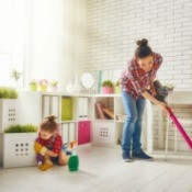 Woman and daughter cleaning house.