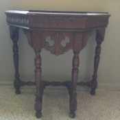 Value of a Mersman Table - ornate small wall table