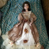 Identifying a Golden Keepsakes Doll  - doll wearing a long mauve dress with a white ruffled petticoat
