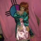 Identifying a Porcelain Doll - red headed doll with pink and green dress