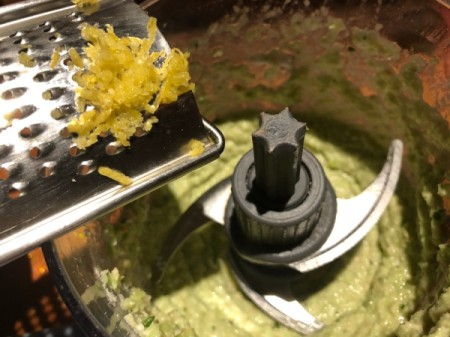 adding garlic to Pesto