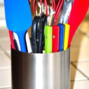 An organized kitchen utility crock.