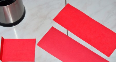Pieces of cardstock cut from a hanging file folder.