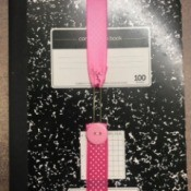 Ribbon Bookmark - ribbon stretched over a composition book