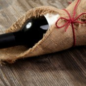 Bottle of wine wrapped in burlap.