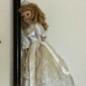 Identifying a Porcelain Doll - doll wearing a long white dress and a tiara