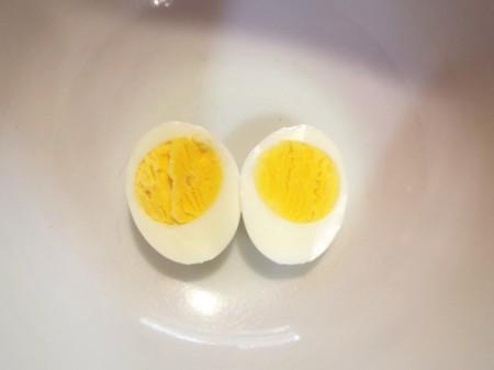 A hard boiled egg cut in half.