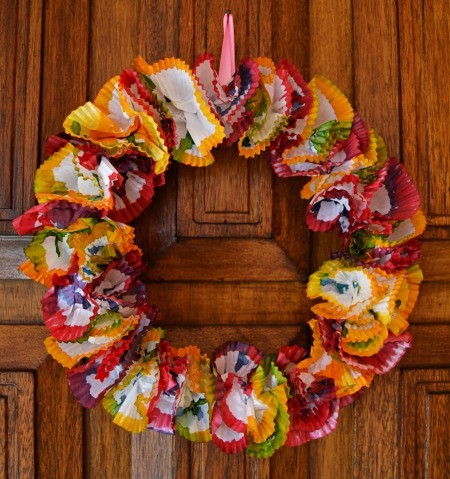Color Explosion Summer Wreath - finished paper liner wreath hanging on a door