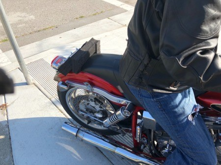 A homemade sissy bar on the back of a motorcycle.