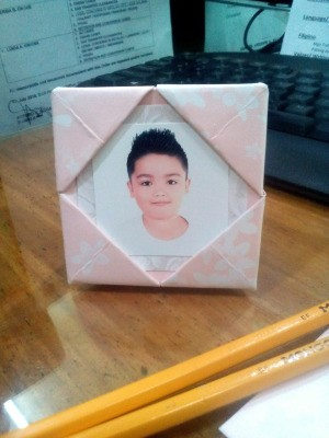Folded Paper Photo Frame - pink and white folded paper photo frame with a child's photo in place