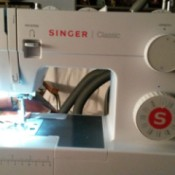 Feed Dog on Singer Sewing Machine Not Working - white plastic housing sewing machine