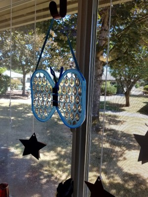 Butterfly Suncatcher Using Unique Lids - hanging in window