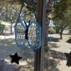 Butterfly Suncatcher Using Unique Lids - hanging in window