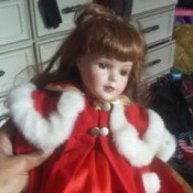 Identifying Porcelain Dolls - doll wearing a red dress and coat with white fur edging