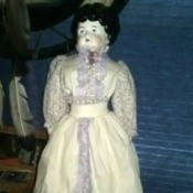 Value of a Porcelain Doll - antique looking doll in long white dress