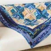 Blue quilt on a white sofa.