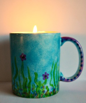Mug Turned Colorful Candle Holder - candle burning inside the cup