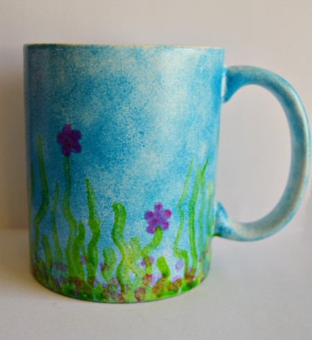 Mug Turned Colorful Candle Holder - paint magenta flowers and add some dots in the same color around the bottom in the grass