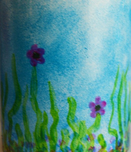 Mug Turned Colorful Candle Holder - mix the emerald and blue glaze to make a darker green and add shadows to the grass shoots and to color the center of the flowers