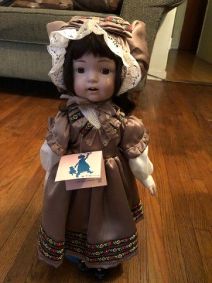 Value of Ashley Belle Doll - doll wearing a brown dress and matching lace edged bonnet
